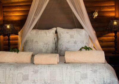 Log cottage bedroom