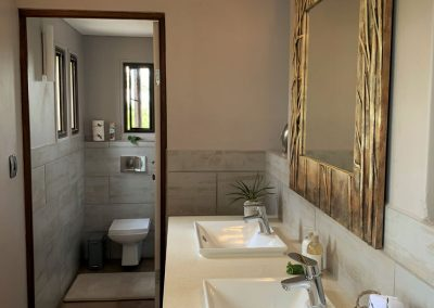 Luxury Bush Villa bathroom and double-sink wash up area