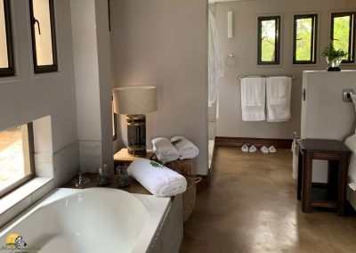 Luxury Bush Villa bath and entrance to shower and wash up area