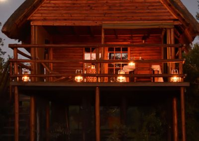 Log Cabin exterior at night